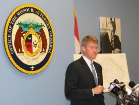 Mo. Attorney General Chris Koster speaks to reporters about Thursday's amended lawsuit settlement with Republic Services.