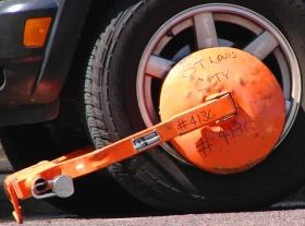 The city of St. Louis resumed using wheel clamps, or parking boots, in 1999 to compel vehicles owners to pay outstanding parking tickets. The clamp immobilizes the vehicle and is designed to prevent removal of both itself and the wheel. In St. Louis, the interval between the when a car is booted and when it's towed to the impound can be as little as 15 minutes.