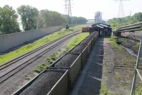 Train cars of coal at ACL's St. Louis coal terminal will be dumped out and put on Louisiana-bound barges.