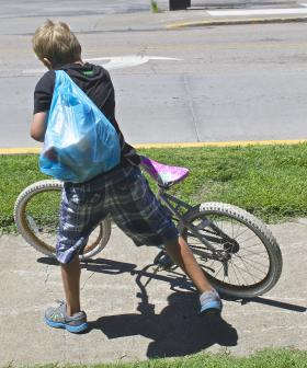 Older children often help their younger siblings carry their lunches home.