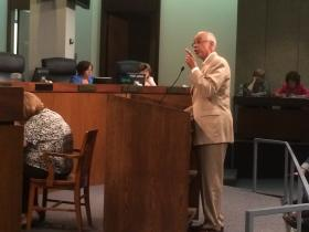 Mike Jones, an adviser to St. Louis County Executive Charlie Dooley, speaks during Tuesday's St. Louis County Council meeting. Jones offered a scathing rebuke to Councilman Steve Stenger's criticism over his actions on the state Board of Education.
