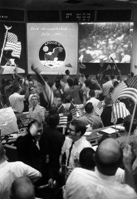 Mission Control in Houston celebrates on July 24, 1969, after the crew of Apollo 11 has safely returned to Earth, and their capsule has splashed down in the Pacific Ocean.