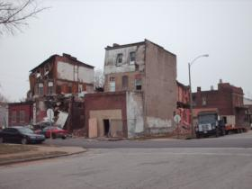 "The damage caused by a December 2012 windstorm forced the demolition of all three buildings on ""Tillie's Corner,"" making the site ineligible for listing on the National Register of Historic Places."