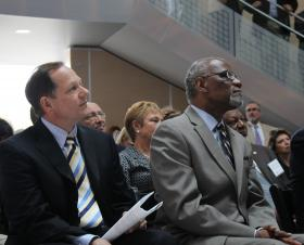 St. Louis Mayor Francis Slay and St. Louis County Executive Charlie Dooley listen on during Paz's speech.