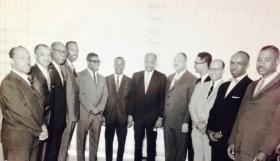 The original investors in Gateway Bank included judge Clyde Cahill (first gentleman on the left), Mel Harrington (4th gentleman), chairman emeritus Clifton Gates (7th gentleman), Dr. Jerome Williams (9th gentleman) and Jim Hurt (11th gentleman). The others have yet to be identified.