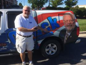 "Rep. Chuck Gatschenberger poses in front of his ""Chuck Truck."""