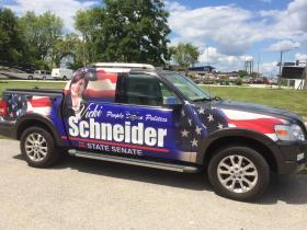 "Former Rep. Vicki Schneider's ""truck wrap"""