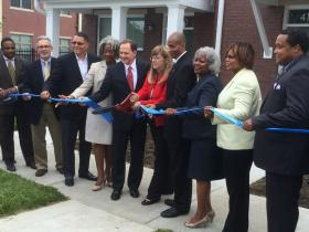 Business and political leaders cut the ribbon on the expansion to the North Sarah Community.
