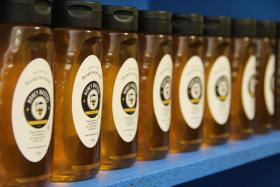 Bottles of Honey Masters honey line the shelves in Sweet Sensations offices.