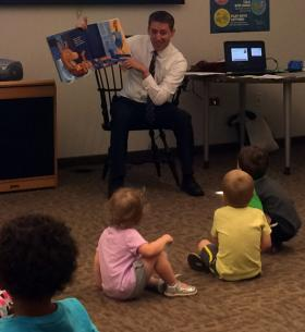 Missouri Secretary of State Jason Kander reads to toddlers at Kirkwood Public Library on Thursday, July 10, 2014.