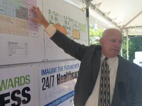 Developer Paul McKee outlines his plans for an urgent care hospital at 25th Street and Maiden Lane on Wednesday. He estimates the project will cost between $12-$15 million and will be financed privately.