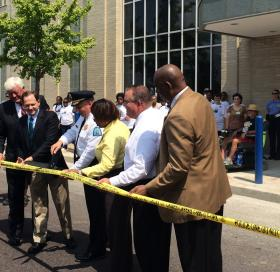 The ribbon-cutting ceremony used crime tape instead of ribbon during the opening of the new Metropolitan Police Headquarters Saturday, July 19, 2014.