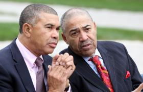 U.S. Rep. Lacy Clay, left, and former U.S. Rep. Bill Clay converse at a bridge dedication. Some state lawmakers and city aldermen are supporting Carter because they don't care for Clay.