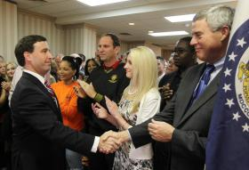 Steve Stenger shakes hands with Bob McCulloch at Stenger's kickoff in 2013.