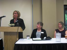 U.S. Rep. Ann Wagner of Missouri addresses a panel on human trafficking. Listening are Dr. Denise DeGarmo of Southern Illinois University-Edwardsville and Deidre Lhamon of The Covering House.