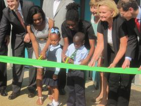 Jaden Brooks and Ayden Abu cut the ribbon at KIPP Victory as Sen. Claire McCaskill and others look on.
