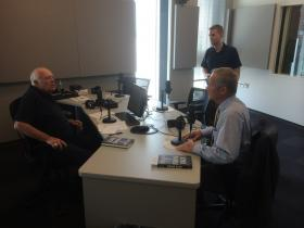 "Former U.S. Rep. Todd Akin, right, talks to ""St. Louis on the Air"" host Don Marsh, left, and producer Alex Heuer before Tuesday's show."