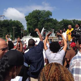 Protesters gather in front of the Ferguson Police Department.