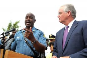 Capt. Ron Johnson and Gov. Jay Nixon address the press on Aug. 15.