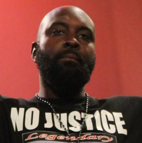 Michael Brown Sr., shown here from the rally held a week ago, appealed for peace on the day of his son's funeral.