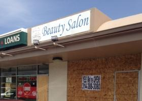 Three T's Beauty Salon didn't suffer broken windows or looting, but owner Triondus Sleet put plywood up as a precaution.