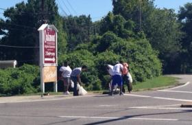 Volunteers clean up along West Florissant Avenue on Wednesday morning.