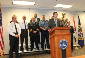 FBI director James Comey addresses the media after meeting with the heads of about a dozen local law enforcement agencies. Comey was in St. Louis to tour the agency's field office.