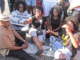 """State Sen. Maria Chappelle-Nadal (center) and others """"sit down for Michael Brown"""" on West Florissant in Ferguson Wednesday."""
