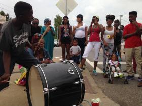 Drummers attract a crowd during sixth night of demonstrations in Ferguson.