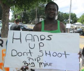 Rickey Canamore is among the protesters maintaining a vigil across from the Ferguson police department.