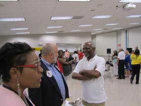 Charlie Dooley mingles with supporters at election-eve rally in Hazelwood.