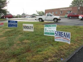 Yard signs for the Republican and Democratic candidates for St. Louis County executive adorn the parking lot of an Affton polling place