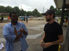 St. Louis Alderman Antonio French, D-21st Ward, chats with Jack Dorsey last Sunday at the QuikTrip in Ferguson. Dorsey, a St. Louis native who helped create Twitter, is one of the many people who ventured to Ferguson from out of town.