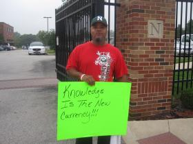 John Phillips displays his message for Normandy students.