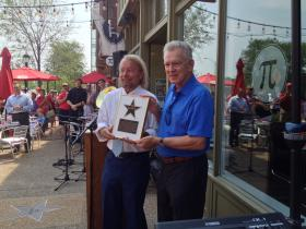 Joe Edwards helps to celebrate Tim McCarver's new star on the St. Louis Walk of Fame Monday.
