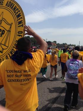 Despite soaring temperatures, hundreds turned out for the St. Louis County NAACP's youth march in Ferguson on Saturday afternoon.