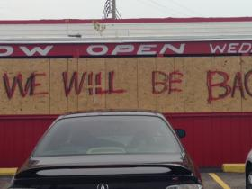 Red's BBQ on West Florissant Ave. The restaurant sustained damage after protesters broke in and set it on fire.