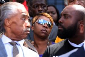 The Rev. Al Sharpton (left) and Lesley McSpadden, the mother of Michael Brown (center).