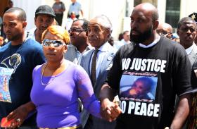 The parents of Michael Brown -- Lesley McSpadden (left) and Michael Brown Sr. -- appeared Tuesday at a rally with the Rev. Al Sharpton