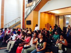 Community members listen to activist and author Kevin Powell speak.