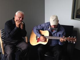 """Phil Sardo, left, and his brother Tony Sardo practice Friday morning at St. Louis Public Radio before """"Cityscape."""""""