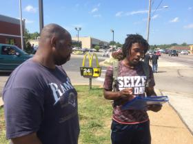 Marcellus Buckley, right, and Alex Collins stand outside the McDonald's on South Florissant Avenue in Ferguson.