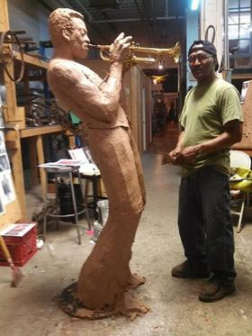 Sculptor Preston Jackson with his cubist-influenced Miles Davis statue clay model.