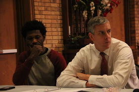 U.S. Secretary of Education, Arne Duncan, speaks with community organizers and activists during a meeting at Greater St. Mark Missionary Baptist Church in north St. Louis County.