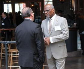 St. Louis County Executive Charlie Dooley talks with Jeff Rainford, chief of staff for St. Louis Mayor Francis Slay. Dooley has emphasized his cooperation with city leaders, but has generally shied away from backing or opposing a specific city-county merger concept.