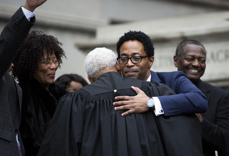 St. Louis County Prosecutor Wesley Bell hugs Missouri Supreme Court Judge George Draper III on Jan. 1, 2019. Bell is the first African-American to serve as St. Louis County prosecutor. Jan. 1, 2019