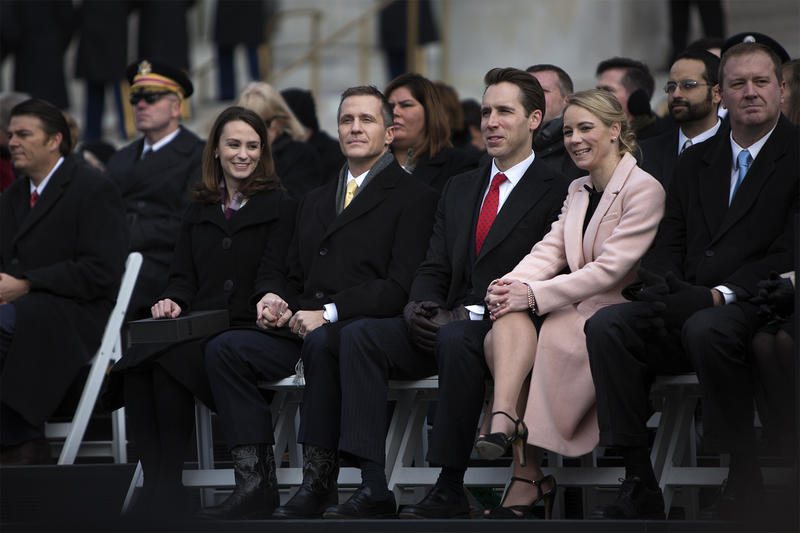 Eric Greitens sits beside his wife, Sheena Greitens, and Attorney General Josh Hawley and his wife, Erin Morrow Hawley.