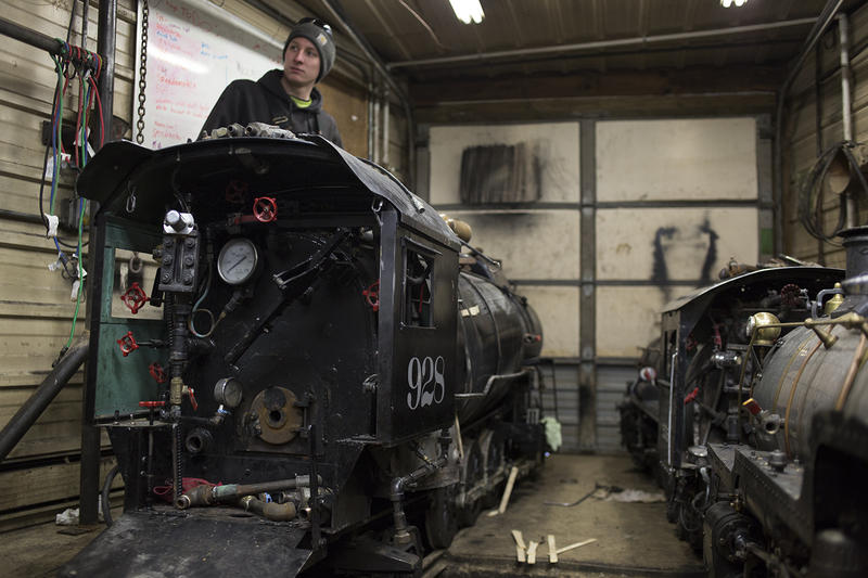 Devin Lawson of south St. Louis County works to dry out the boilers in the Wabash, Frisco and Pacific Railroad Association's 12-inch gauge steam engines.