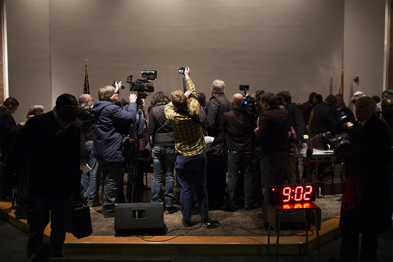 Reporters gather to interview Mayor James Knowles III following Tuesday's city council meeting.