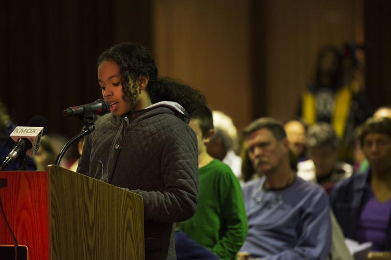 Ferguson resident Mauraye Love, 9, speaks to city council members Tuesday night.